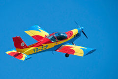 Aircraft performing at the Romanian Air Show. A Zlin Extra airplane performing aerobatics against the blue sky, at the Romanian Air Show, which took place May 18 royalty free stock photo