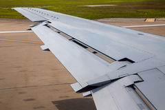 Aircraft plane wing taking off on airport Royalty Free Stock Image