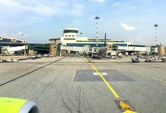 Aircraft in preparation for the flight in Milan Malpensa International Airport, Terminal 1. Ferno, Milan, Italy - May 5, 2018: Aircraft in preparation for the Royalty Free Stock Photos