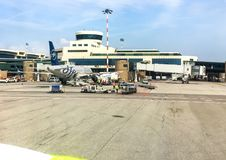 Aircraft in preparation for the flight in Milan Malpensa International Airport, Terminal 1. Ferno, Milan, Italy - May 5, 2018: Aircraft in preparation for the Stock Image