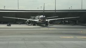 Aircraft prepare to take off and loading baggage at Suvarnabhumi airport stock video footage