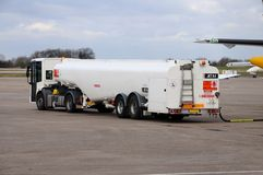 Re-fuelling petrol tanker. Aircraft re-fuelling petrol tanker on the airport apron, East Midlands Airport, Leicestershire, England, UK, Western Europe Royalty Free Stock Photos