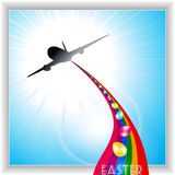 Aircraft release Easter eggs on rainbow Stock Photo