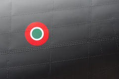 Aircraft roundel. Italian airforce roundel symbol on a riveted aircraft fuselage Stock Photos