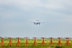 Aircraft on runway approach at East Midlands Airport. East Midlands Airport IATA: EMA, ICAO: EGNX is an international airport in the East Midlands of England stock images