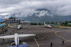 The aircraft on the runway of the Tenzing-Hillary airport Lukla royalty free stock photography