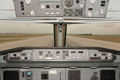 Aircraft runway view. View of runway from an airliner cockpit ready for takeoff Royalty Free Stock Photography