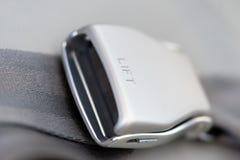 Aircraft seat belt buckle closeup fasten belts Stock Photography