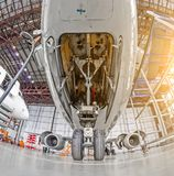 Aircraft service, view of the front landing gear of the chassis. Aircraft service, view of the front landing gear of the chassis Royalty Free Stock Photo