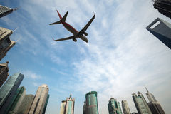 Aircraft in shanghai. Aircraft with shanghai skyline of the lujiazui financial center royalty free stock photo