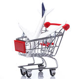 Aircraft in shopping trolley Royalty Free Stock Photo