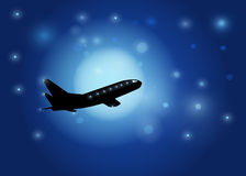 The aircraft silhouette on in the night sky and the moon backgro Stock Photography