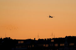 Airplane silhouette at sunset. Royalty Free Stock Photos