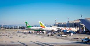 Aircraft sitting on the runway at Los Angeles International LAX Airport. Los Angeles, USA - 25  September 2016: Aircraft sitting on the runway at Los Angeles Royalty Free Stock Photos