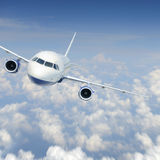 Aircraft in the sky. Aircraft in the cloudy sky stock photography
