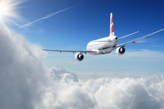 Aircraft in the sky. Aircraft in the cloudy sky Royalty Free Stock Photos