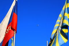 The aircraft in the sky between the flags of the Russian Federation and the Russian Air Force. Royalty Free Stock Photos