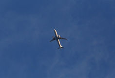 Aircraft in a sky. Aircraft flying in a blue sky Royalty Free Stock Images