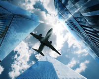 Aircraft between skyscrapers Royalty Free Stock Photos