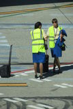 Aircraft staff with their luggage at the airport Royalty Free Stock Photography