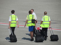 Aircraft staff with their luggage at the airport Stock Image