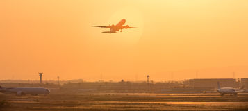 Aircraft starting in the evening from an airport Stock Photo