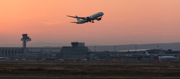 Aircraft starting in the evening from an airport Royalty Free Stock Photo