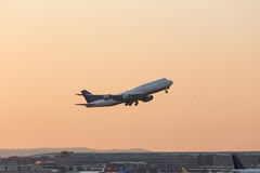 Aircraft starting in the evening from an airport. An aircraft starting in the evening from an airport Stock Photos