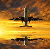 Aircraft. In the sunset sky Stock Images