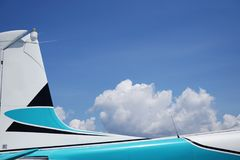Aircraft Tail Close up with White clouds Background. stock photos