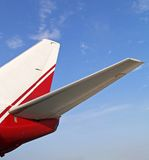 Aircraft tail wing. Blue sky on background Stock Photos