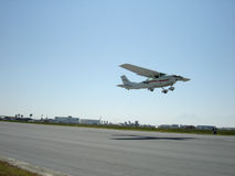 Aircraft Takeoff 2. Aircraft with top wing take off on clear day Royalty Free Stock Photo