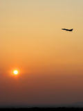Aircraft takeoff at sunset Stock Photography