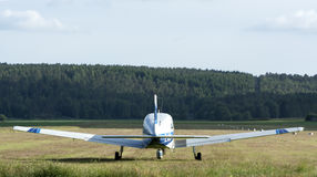 Aircraft taking off. Forest background Stock Photography