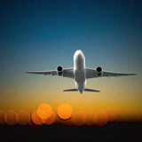 Aircraft taking off. With lights from airport in background. 3D effect Royalty Free Stock Image