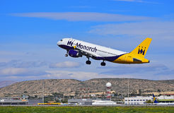 Aircraft Taking Off. A Monarch Airlines passenger plane just after take off from Alicante Airport on Spains Costa Blanca coast royalty free stock image