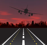 Aircraft is taking off at sunset Royalty Free Stock Photography