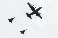 Aircraft tanker during refueling two fighter jets. Royalty Free Stock Photography