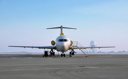 Aircraft on the tarmac. An aircraft parked on the tarmac of an international airport in Ontario, Canada royalty free stock photo