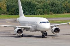 Aircraft taxiing on the airport apron steering track.  stock image