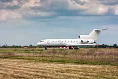The aircraft taxiing on the main taxiway. In a small airport royalty free stock images