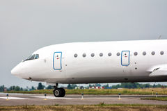 The aircraft taxiing on the main taxiway. In a small airport royalty free stock photography