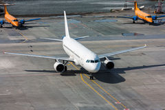 The aircraft taxiing to a parking. In the airport Royalty Free Stock Images