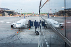 The aircraft in the terminal Royalty Free Stock Photos