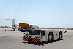 Aircraft Tow Tractor. In airport Royalty Free Stock Image