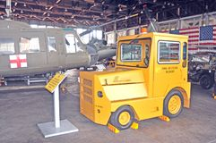Aircraft Tow Tractor. The aircraft tow tractor, or pushback as it is also known, is used to move aircraft about an airfield or on an aircraft carrier on the royalty free stock image