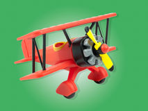 Aircraft toy isolated on green Royalty Free Stock Photos