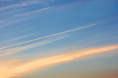 Aircraft track in the evening sky Stock Image