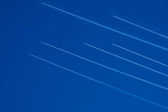Aircraft traffic. Airliners  the blue sky. Stock Photos