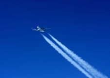 Aircraft and trail Stock Photo